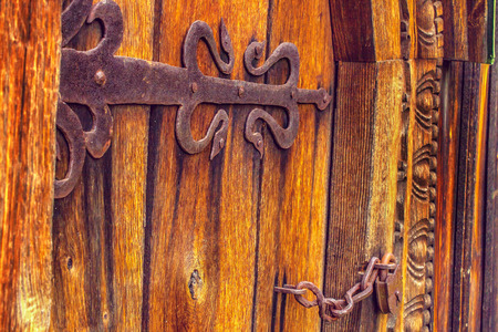 medieval blacksmith: a antique wooden doors on forged curtains locke Stock Photo