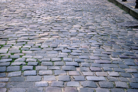 empedrado: background image of old road paved with granite stones Foto de archivo