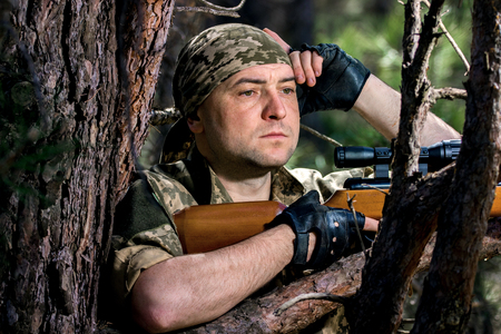 image of a young man with an air rifle Stok Fotoğraf