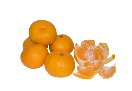 image of whole tangerines and one peeled on white background 写真素材