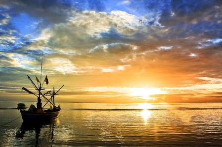 miror: a boat with beautiful reflection in a seascape at sunrise Stock Photo