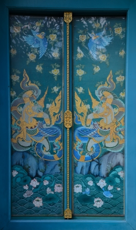 Thai temple door with ramayana painting photo