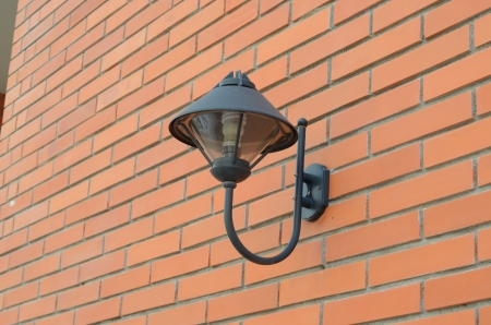 modern lighting on orange brick wall photo