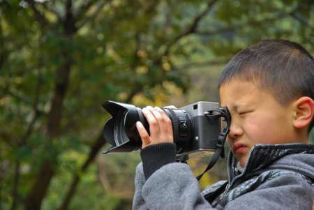 Photographer children.Photography-loving children,Photographer,Chinese Stock Photo - 12779000