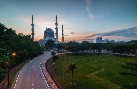 muslim prayer: Sunrise-blue mosque shah alam