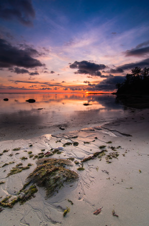Tips of borneo sunset with stone vertical view photo