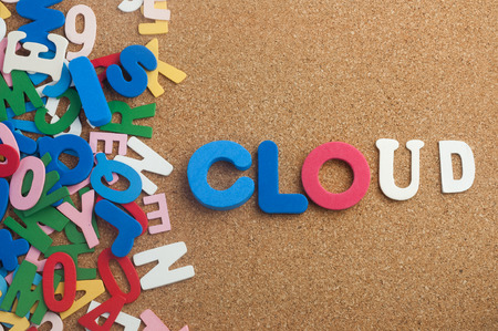 Colourful word cloud with cork board as background Stock Photo