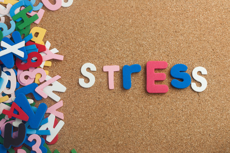 Colourful word stress with cork board as background Stock Photo