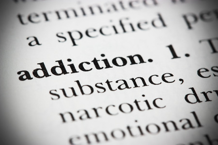 addiction alone: Close up of a dictionary word  Stock Photo