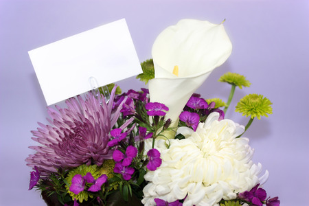 Flower arrangement with a blank white card photo