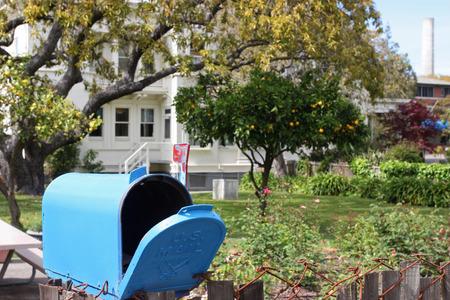 Blue mailbox in quiet neighborhood photo