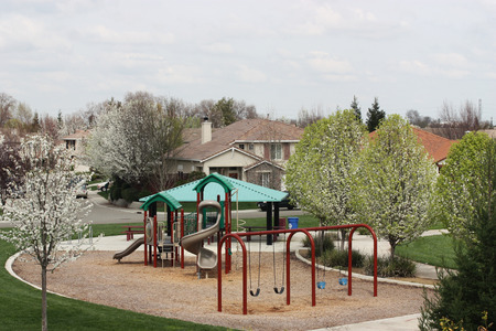 rural community: Small Neighborhood Playground in residential community Stock Photo