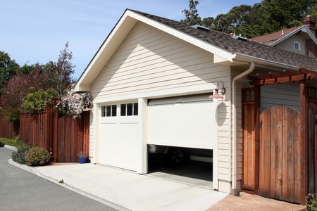 car garage: Open garage door in suburban house
