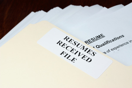 resumes: File with stack of resumes received