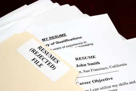 rejected: File with stack of rejected resumes