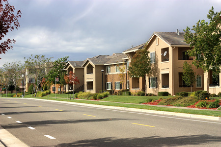 residential: Modern apartment complex in suburban neighborhood Stock Photo