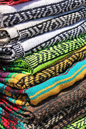 multi layered: Stack of colorful blankets Stock Photo