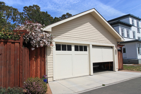 doors open: Open garage door in suburban house