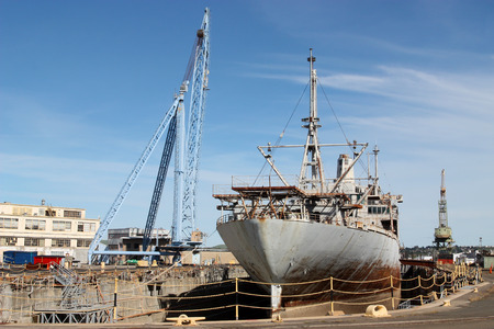 ship wreck: Old rusty ship on dry dock