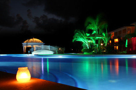 swimming candles: Beautiful resort pool at night