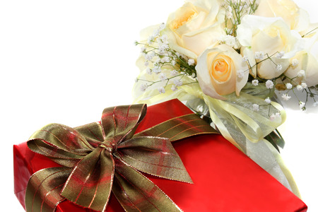 Red gift box and white roses