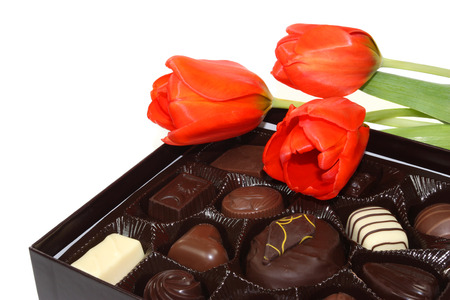 Red tulips and box of chocolate candy