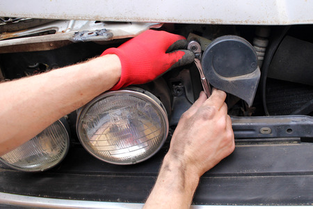 Technician fixing old broken car