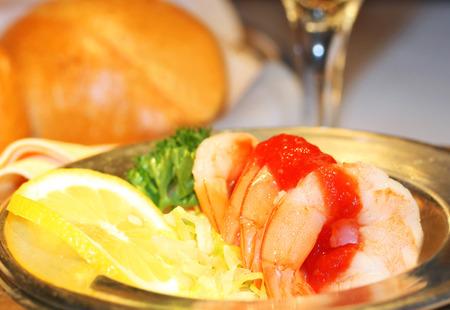 Shrimp cocktail appetizer with lemon at the restaurant