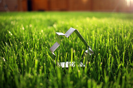cookie cutter: Cookie Cutter Home Metaphor Stock Photo