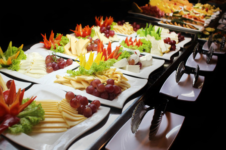 buffet dinner: Variety of cheese on plates