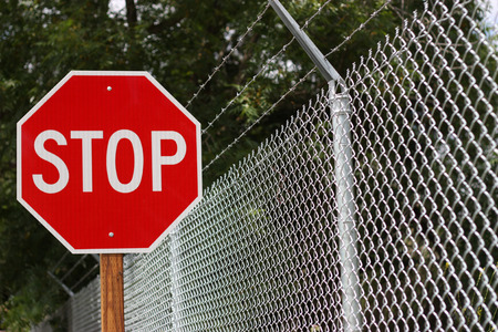 Stop sign near the fence