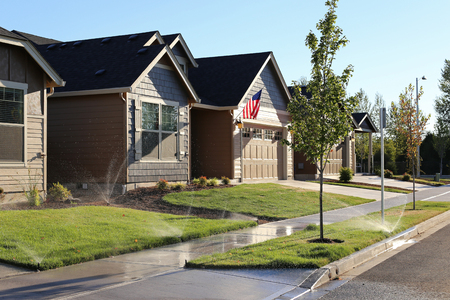 sprinkler: Family homes in suburban neighborhood