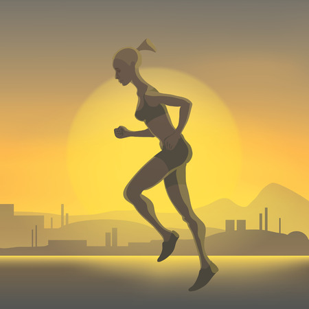 morning walk: Silhouette of running girl on a background of the sunset