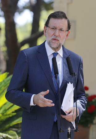 rajoy: Palma de Mallorca, Spain - August 8, 2014 - Spain?s Prime minister Mariano Rajoy gestures while speaking to media Editorial