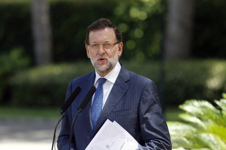 rajoy: Palma de Mallorca, Spain - August 8, 2014 - Spains prime Minister Mariano Rajoy gestures during a media comference in the island of Mallorca after summer meeting with king Felipe during the monarch summer holidays in the Spanish island.