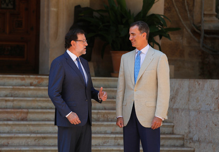 rajoy: Palma de Mallorca, Spain - August 8, 2014 - Spains King Felipe (R) and Prime minister Mariano Rajoy speak before their summer meeting at the Marivent Palace in the spanish island of Mallorca.