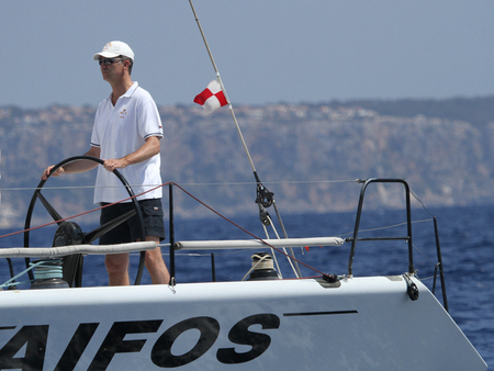 Palma de Mallorca, Spain - August 1, 2013 - Spain King Felipe sails aboard Aifos racing sailing yacht during the start of the Copa del Rey Regatta in the island of Mallorca.