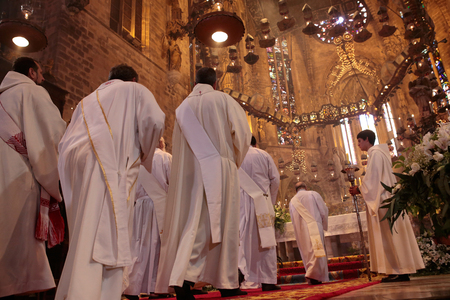 Palma de Mallorca, Spain - September 19, 2016 - Priests walk to main altar in the Cathedral of Palma de Mallorca during a morning mass