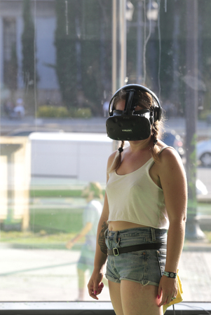 Barcelona, Spain - June 15, 2017 - A woman uses a virtual reality headset at Sonar advanced music and arts festival.