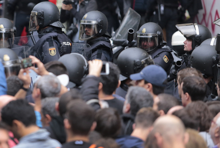 squad: Barcelona, Spain - October 1, 2017 - Spanish police riot squad prepares to charge during the banned pro independence referendum in central barcelona