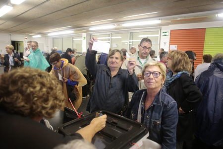 Barcelona, Spain - October 1, 2017 - Voters pose happy to vote during the banned pro independence referendum in central barcelona