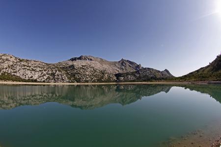 Escorca Mallorca, Spain - June 28, 2011 - Water reservoir of cuber with highest Balearic peak Puig Major reflected