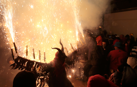 Palma de Mallorca, Spain - January 21, 2018 - Revellers dressed as devils and holding fireworks take part in a traditional Correfoc (fire run) in Palma de Mallorca. correfoc is a traditional celebration amongst Catalonia, Valencia and the Balearic islands