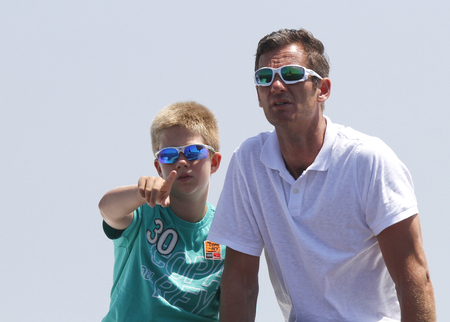 Palma de Mallorca  Spain - August 1, 2011 - Inaki Urdangarin son in law of King Juan Carlos gestures as he watch the copa del rey regatta with his son Juan Valentin and nephew Froilan in Palma de Mallorca bay. Editorial