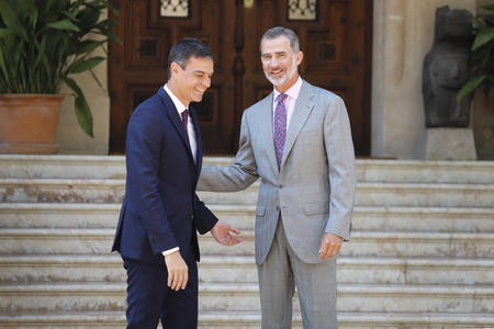 Palma de Mallorca / Spain - August 6, 2018 - Spain King Felipe VI (R) and Prime Minister Pedro Sanchez gesture during their traditional summer meeting in Marivent palace gardens