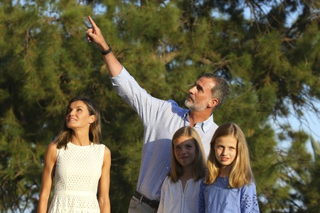 Palma de Mallorca / Spain - July 30, 2018 - Spanish royal family King Felipe and Queen Letizia pose with their daughters princesses Leonor and Sofia in Palma de Mallorca during their summer holidays in Almudaina gardens