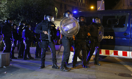 Barcelona, Spain - October 1, 2018 - Catalan Mossos Esquadra police prepares before charging against the crowd protesting during the 1st protests in Barcelona to claim the independence of Catalonia to spain Editorial