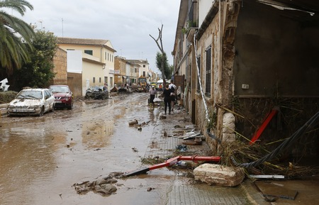 Sant Llorenc Mallorca, Spain - October 12, 2018 - Rescue workers clear debris after at least 11 people were killed by heavy rain and flash floods hit Sant Llorenc de Cardassar on the island of Mallorca