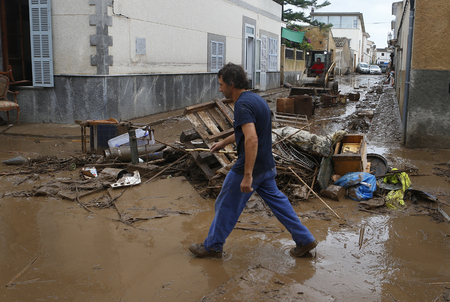 Sant Llorenc Mallorca, Spain - October 13, 2018 - Locals and rescue workers clear debris after at least 11 people were killed and heavy flood hit Sant Llorenc de Cardassar on the island of Mallorca