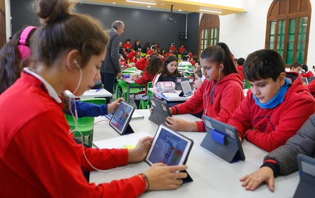 Palma de Mallorca, Spain - November 27, 2018 - Students in their classroom on an experimental educational system bringing 120 students and 6 teachers on the same class following a leading teacher lesson Editorial